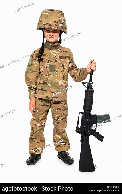 Young boy dressed like a soldier with rifle isolated on white