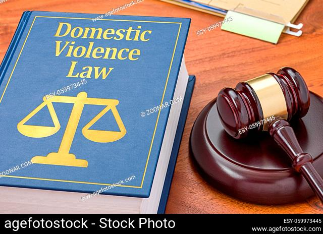 A law book with a gavel - Domestic violence law