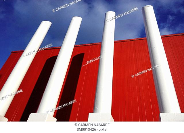 Warehouse facade red with white columns
