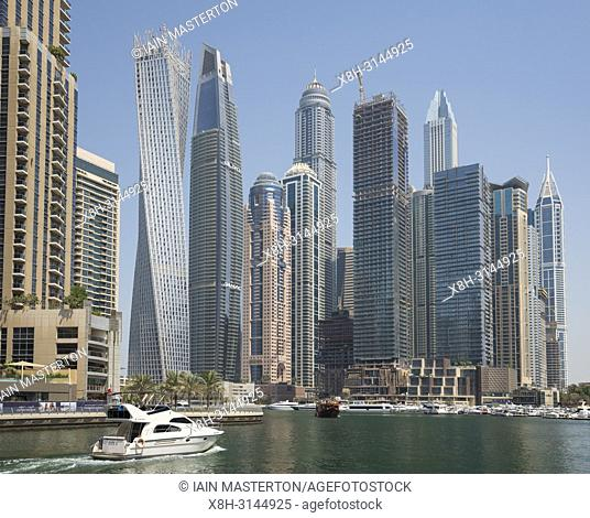 Many high rise apartment towers and skyscrapers in Marina district of Dubai, UAE, United Arab Emirates