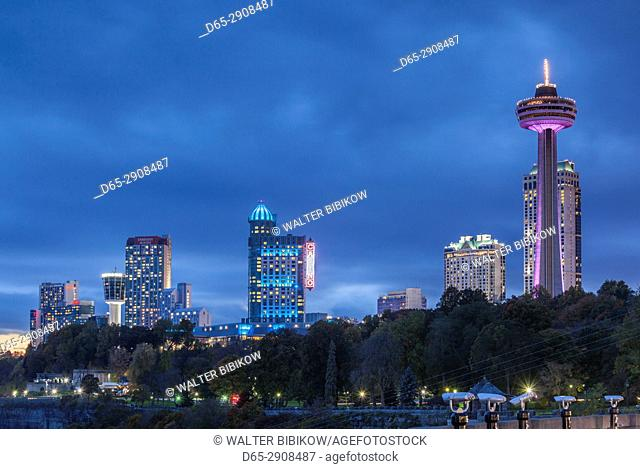 Canada, Ontario, Niagara Falls, hotels by the falls and Skylon Tower, dusk