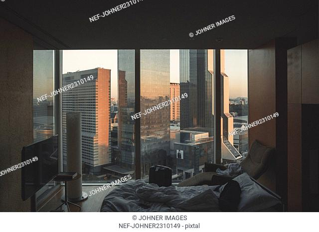 Hotel room with view of modern skyscrapers