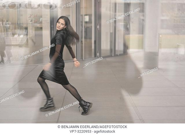 dancing woman with closed eyes, sensual, blurred, indoors, walking, movement