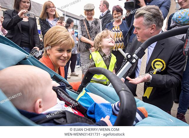 SNP Leader Nicola Sturgeon joins John Nicolson on the campaign trail in Kirkintilloch, as they visit a street stall at the Regent centre