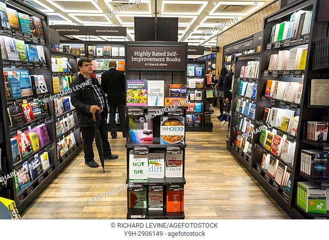 Customers shop and browse in the new Amazon Books in the Time Warner Center in New York on opening day, Thursday, May 25, 2017