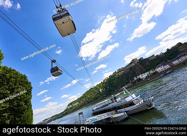 29 May 2020, Rhineland-Palatinate, Koblenz: The cable car, which crosses the Rhine between Deutsches Eck and Ehrenbreitstein Fortress, is running again