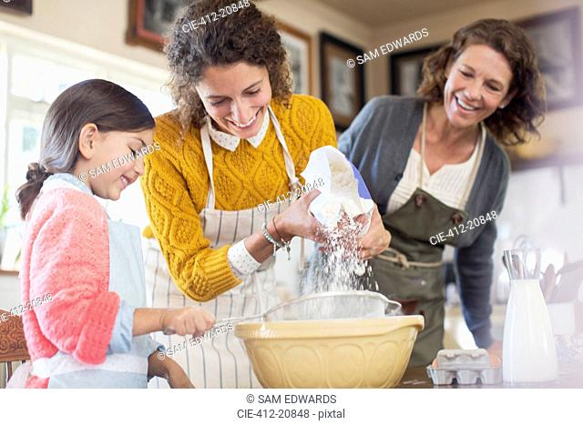 Three generations of woman baking together