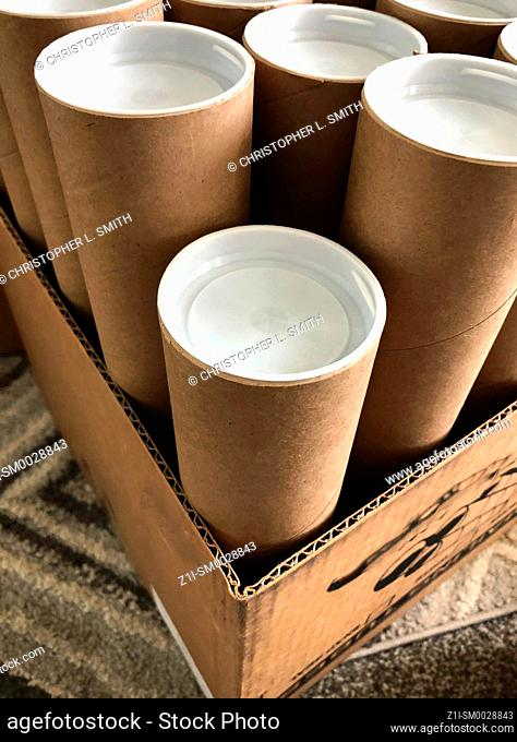 Recycled cardboard mailer tubes with white plastic end caps
