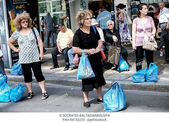People waiting for the bus at a shopping street near Omonia square in Athens, Greece on the 2nd of July 2015. Greece's government has made new concessions in...