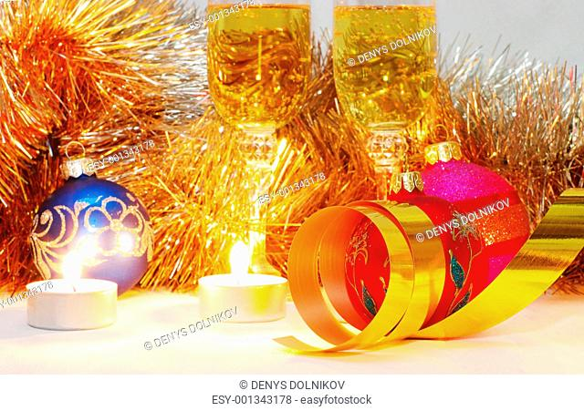 The burning candles, balls and ribbons it are Christmas