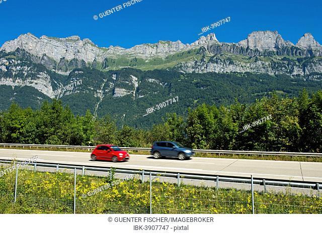 Vehicles on the A3 motorway in front of the Churfirsten range near Lake Walen, Canton of St. Gallen, Switzerland