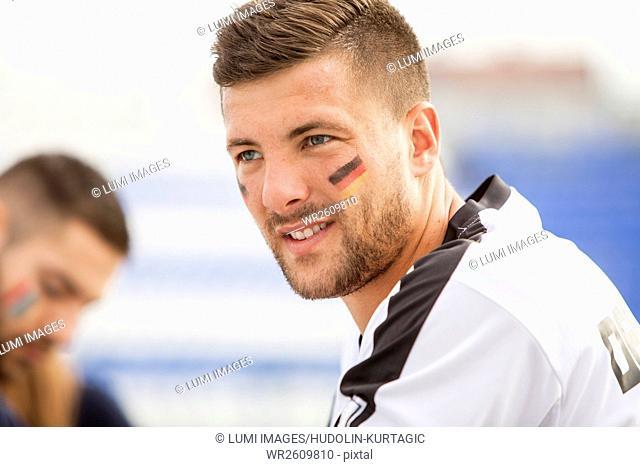 Portrait of German soccer fan with face paint