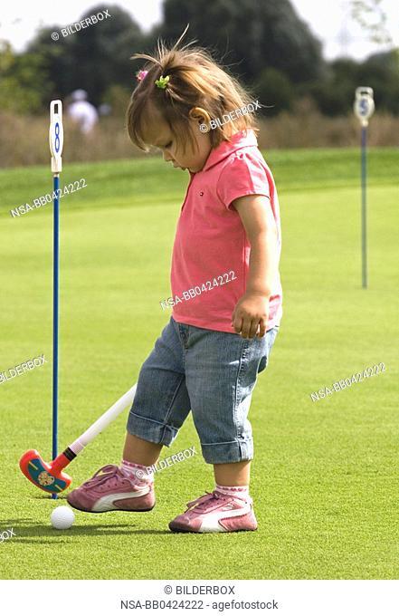 girl is golfing
