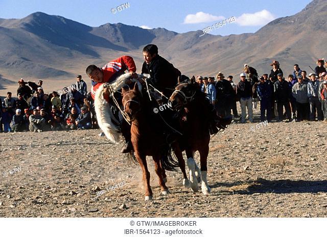 Kek Bar, game similar to the Buzkashi, horsemen competing for a goat skin, Golden Eagle Festival, Bayan Oelgii, Altai Mountains, Mongolia, Asia