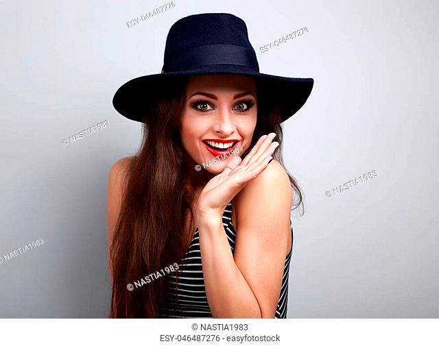 Happy bright makeup surprising woman looking fun in fashion blue hat with empty copy space
