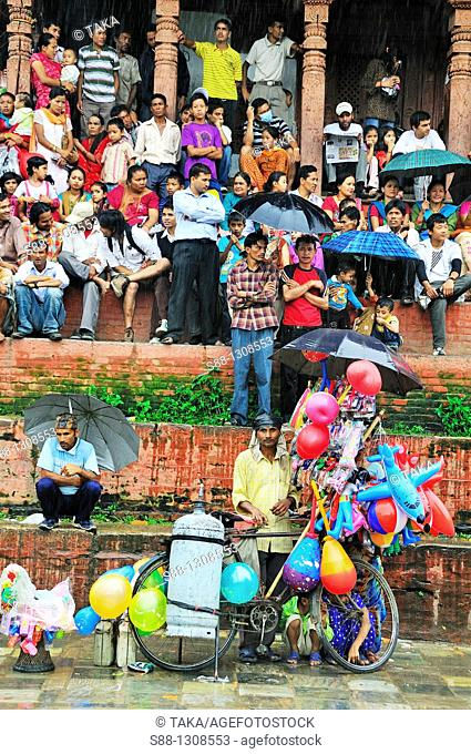 On the day of Gai Jatra festival in August at Durbar square  Spectator watching the festival