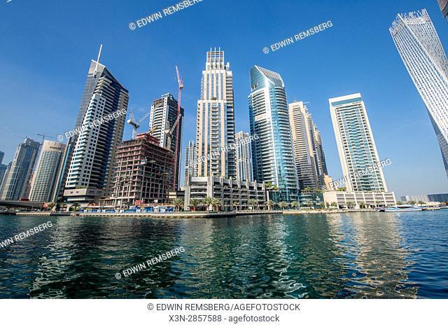 Dubai; United Arab Emirates - Skyscrapers over marina at Dubai