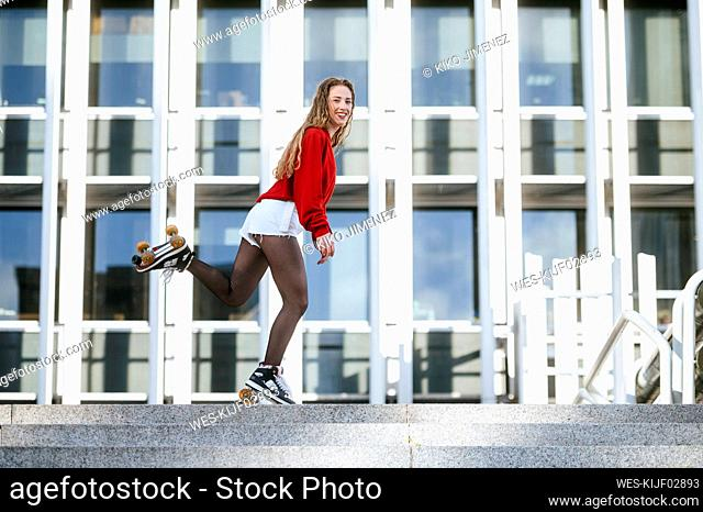 Blond woman balancing with roller skates