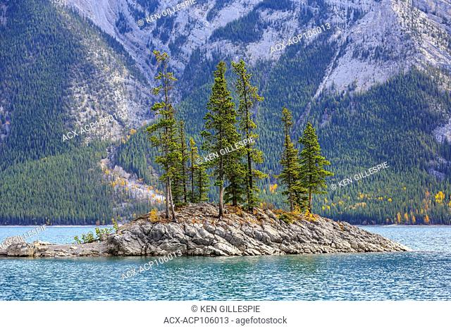 Rocky island on Lake Minnewanka, Banff National Park, Alberta, Canada