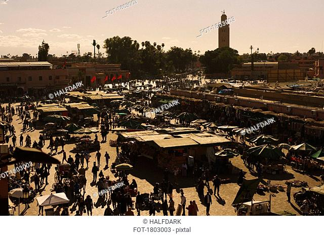 View of bustling souk market in Djemaa El Fna Square, Marrakesh, Morocco