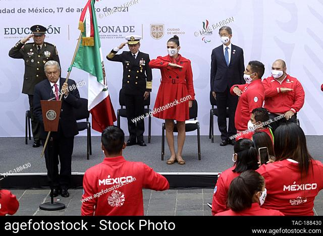 MEXICO CITY, MEXICO - AUGUST 17: Mexican President Andres Manuel Lopez Obrador, holds the nation's flag, accompanied by Director of the National Commission for...