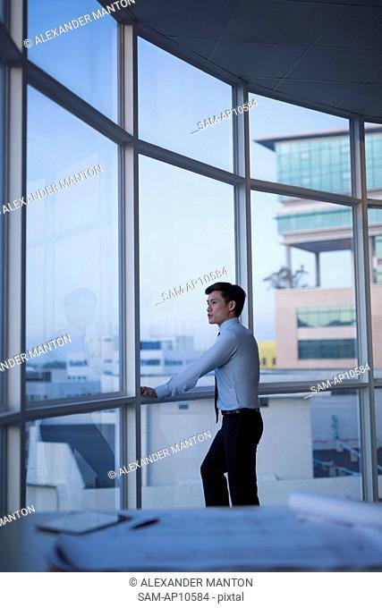 Singapore, Architect leaning against window