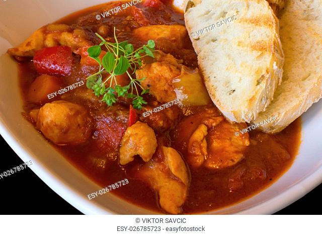 Goulash Soup Homemade. Stew With Fresh Toasted Bread. Goulash Traditional Hungarian Meal