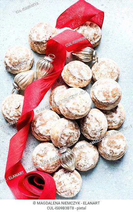 Overhead view of Christmas baubles, red ribbon with fresh scones