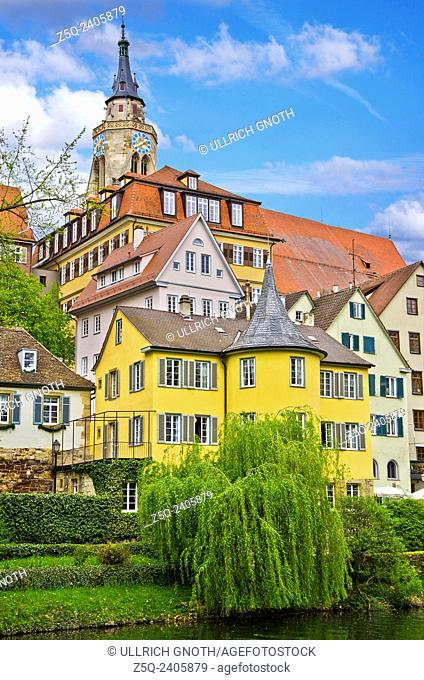 The Neckar river waterfront of Tubingen, Germany, showing its landmarks the Collegiate Church and Holderlinturm tower