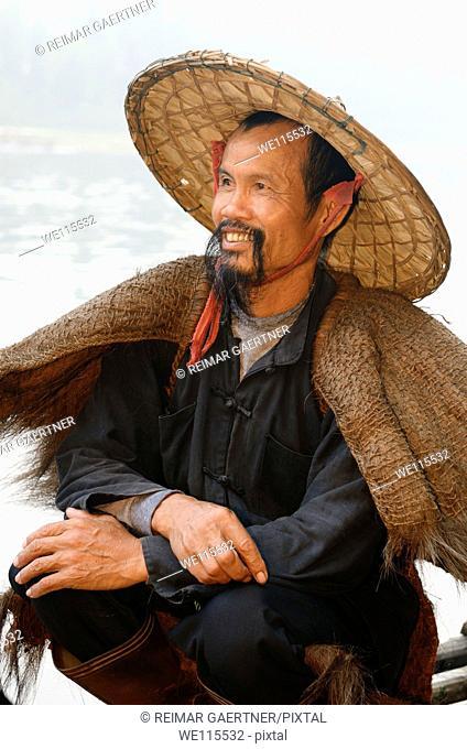 Close up of a smiling cormorant fisherman on the Li river at dawn Xingping China