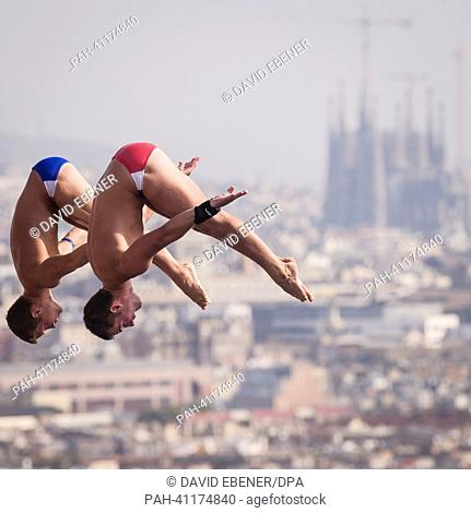 Toby Stanley and David Bonuchi of USA in action during the men's 10m Synchro Platform diving preliminaries of the 15th FINA Swimming World Championships at...