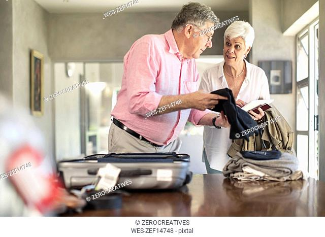 Senior couple packing for a trip together