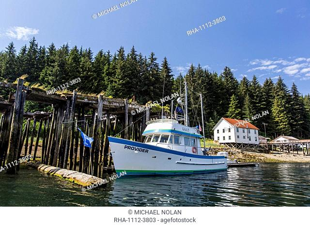 Fishing boat at the dock on Pond Island in Kelp Bay, Baranof Island, southeast Alaska, United States of America, North America