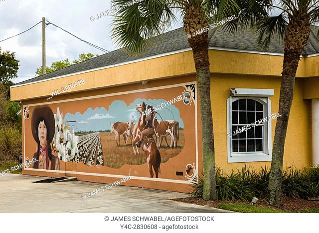 Art murals painted on outdoor building walls in Lake Placid Florida known as the Town of Murals