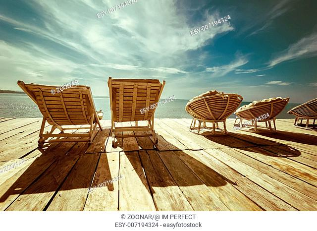 Tropical beach with chairs for relax