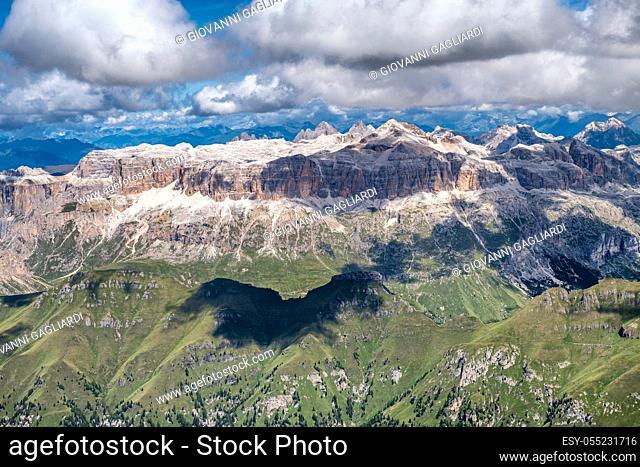 Mountain landscape from Marmolada mountain peak in italian alps against blue sky