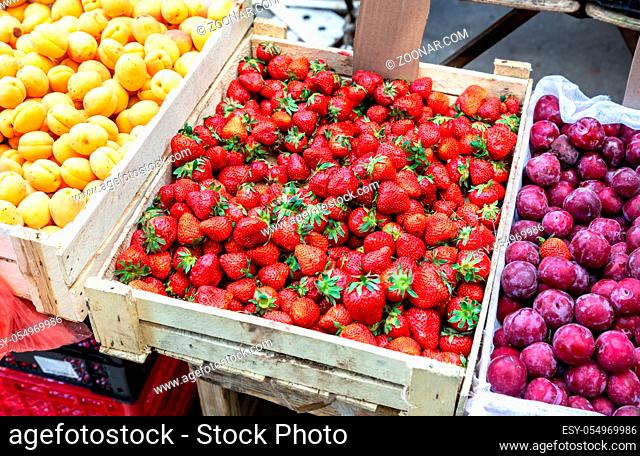 Fresh ripe strawberries ready for sale at the local market