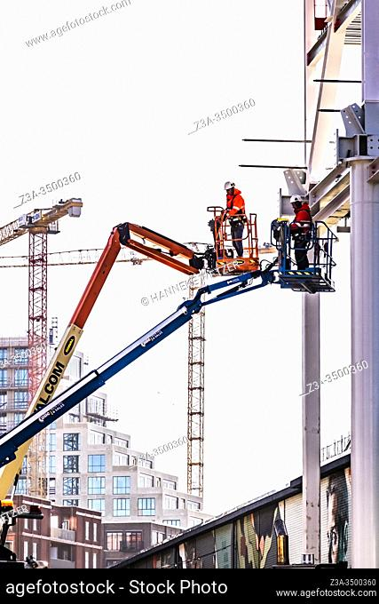 Men working at a construction site at Strijp-S, Eindhoven, The Netherlands, Europe