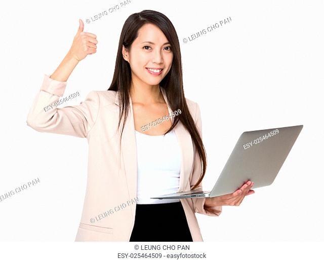 Young businesswoman hold with laptop computer and thumb up