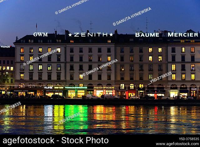 reflections of buildings along Quai des Bergues in Rhone river, downtown of Geneva at dusk, Switzerland