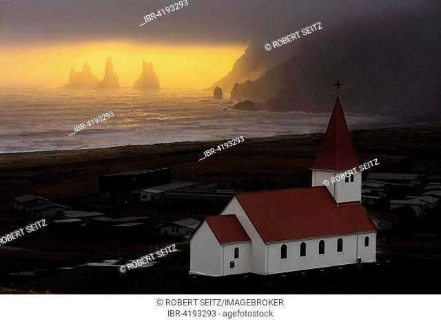 Reynisdrangar with Vik i Myrdal Church, at sunset, Southern Region, Iceland