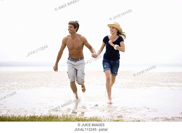 Couple running on beach