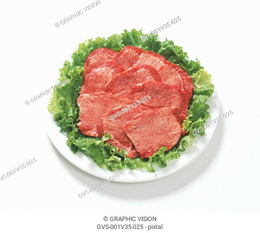 Plate of Uncooked Beef Tongue