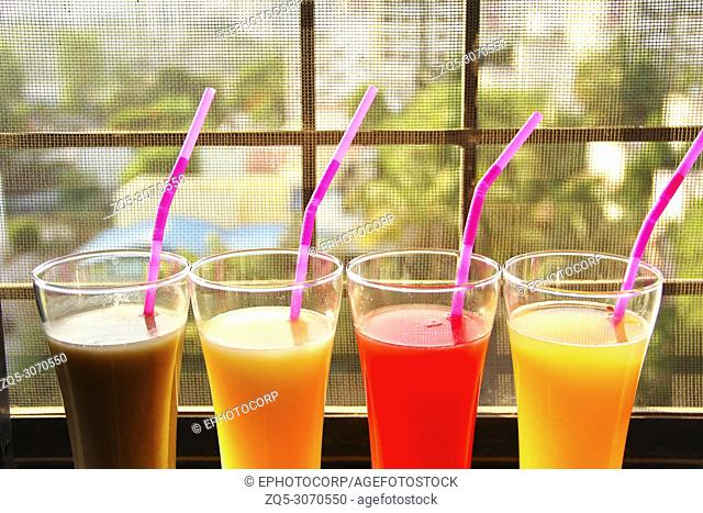 Close view of glasses filled with fruit juices of sapota, mango, watermelon, muskmelon