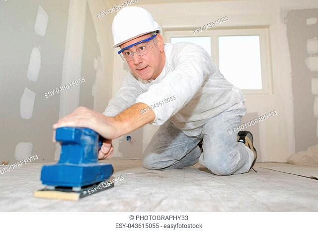 builder sanding floor