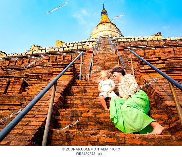 Child and Mom climbing on Buddhist pagoda Shwesandaw in Bagan. Myanmar