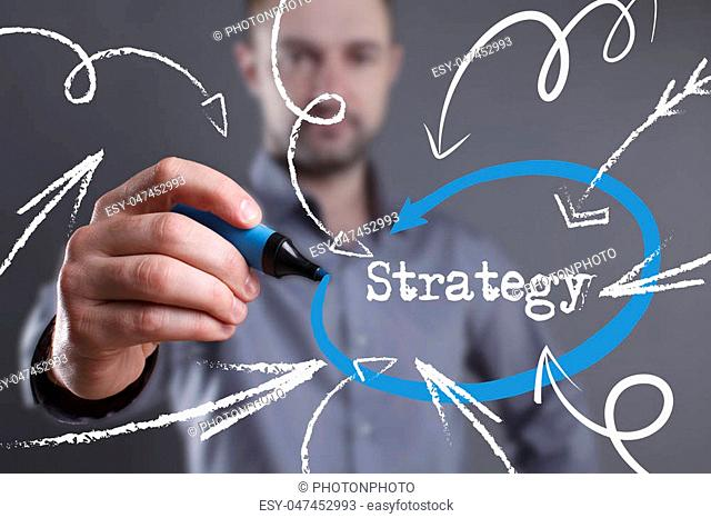 Technology, internet, business and marketing. Young business man writing word: Strategy