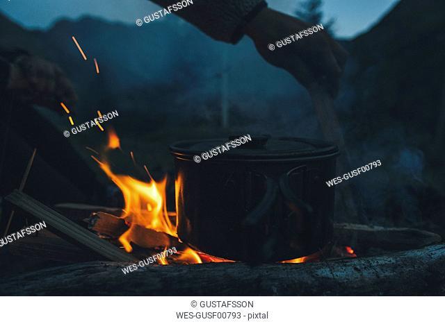 Norway, Lofoten, Moskenesoy, Food cooking on camp fire