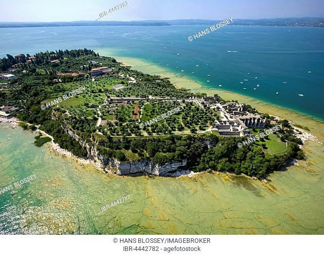 Grottoes of Catullus, archaeological park, peninsula in turquoise waters, Sirmione, Lake Garda, Lombardy, Italy