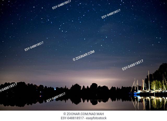 lake landscape at night , beautiful stars sky background